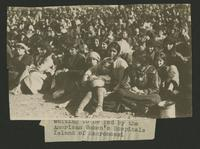 "Waiting to be fed by the American Women's Hospitals, Island of Macronissi (photograph), circa 1922<blockquote class=""juicy-quote"">Photo taken at the refugee camps on the island of Macronissi, Greece after the evacuation of Smyrna (Izmir), Turkey.</blockquote><div class=""view-evidence""><a href=""http://doctordoctress.org/islandora/object/islandora:1492/story/islandora:1499"" class=""btn btn-primary custom-colorbox-load""><span class=""glyphicon glyphicon-search""></span> Evidence</a></div>"