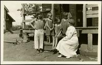 "American Women's Hospitals Service and an Appalachian Mountain family (photograph), circa 1935<blockquote class=""juicy-quote"">An [unidentified] doctor (in hat) from the American Women's Hospital Service sits on the front steps of a porch in rural 1930s Appalachia with a local woman and children.</blockquote><div class=""view-evidence""><a href=""http://doctordoctress.org/islandora/object/islandora:1859/story/islandora:2084"" class=""btn btn-primary custom-colorbox-load""><span class=""glyphicon glyphicon-search""></span> Evidence</a></div>"